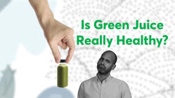 a person holding the hands up: Is Green Juice Really Healthy?