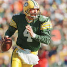 a man holding a baseball bat: Brett Favre went to rehab 3 times during career with Packers