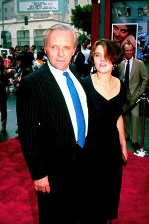 "a person standing in front of Anthony Hopkins, Richard Flanagan posing for the camera: Anthony Hopkins and his daughter Abigail attend the premiere of ""Little Man Tate"" in Los Angeles in 1991."