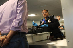 NEW YORK, NY - SEPTEMBER 26:  A Transportation Security Administration (TSA) worker screens luggage at LaGuardia Airport (LGA) on September 26, 2017 in New York City. Passengers traveling on Delta at Terminal C will now go through new automated security screening lanes that hat officials claim will improve security while reducing wait times by 30 percent. The new automated security lanes, which have recently launched at some terminals at neighboring John F. Kennedy Airport, feature four partitioned areas for passengers to load their belongings, as well as a second rotating belt for bins. These bins, which are 25 percent larger, are automatically sent back to the front of the line after each use, freeing up TSA officers to focus on the screening travelers.  (Photo by Spencer Platt/Getty Images)