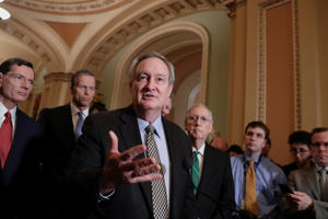 Sen. Mike Crapo, R-Idaho, chairman of the Senate Banking Committee, joined by, from left, Sen. John Barrasso, R-Wyo., Sen. John Thune, R-S.D., and Senate Majority Leader Mitch McConnell, R-Ky., right, talks to reporters as the Senate moves closer to passing legislation to roll back some of the safeguards Congress put in place to prevent a repeat of the 2008 financial crisis, during a news conference at the Capitol in Washington, Tuesday, March 6, 2018.