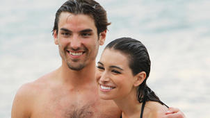Luis Scola standing next to a body of water posing for the camera: 'Bachelor' Alums Ashley Iaconetti and Jared Haibon Are Officially a Couple!