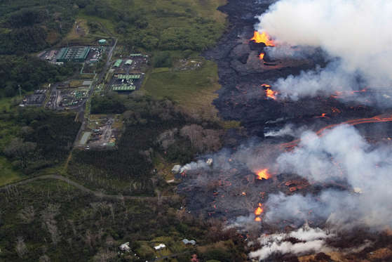 Slide 23 of 204: An aerial view of fissure eruptions near the Puna Geothermal Venture facility, and homes in the Lanipuna Gardens and Leilani Estates subdivisions in Pahoa, Hawaii, USA, 22 May 2018. The ongoing eruption of Kilauea is the largest in decades, destroying more than 40 homes to date, and displacing thousands. Eruptions at Hawaii's Kilauea volcano, Pahoa, Usa - 22 May 2018