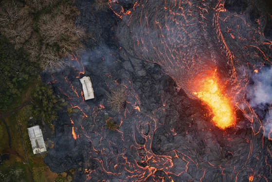 Slide 26 of 204: An aerial view of two storage warehouses, part of the Puna Geothermal Venture's facility, are consumed by an eruption by reactivated fissure 6 in Pahoa, Hawaii, USA, 22 May 2018. The ongoing eruption of Kilauea is the largest in decades, destroying more than 40 homes to date, and displacing thousands. Eruptions at Hawaii's Kilauea volcano, Pahoa, Usa - 22 May 2018