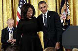 File photo: U.S. President Barack Obama (R) awards the Presidential Medal of Freedom to Oprah Winfrey (C).