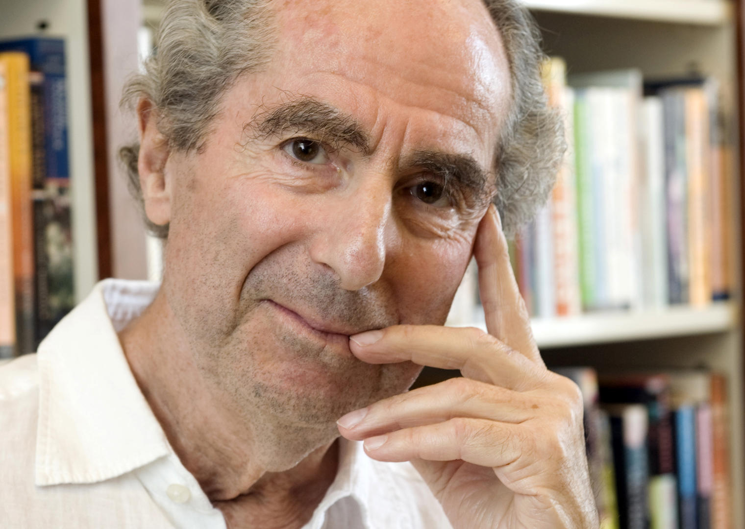 Slide 59 of 158: FILE - In this Sept. 8, 2008, file photo, author Philip Roth poses for a photo in the offices of his publisher, Houghton Mifflin, in New York. Roth, prize-winning novelist and fearless narrator of sex, religion and mortality, has died at age 85, his literary agent said Tuesday, May 22, 2018. (AP Photo/Richard Drew, File)