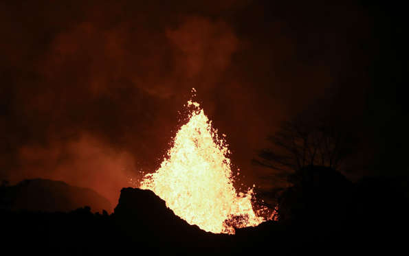 Slide 15 of 204: Lava erupts from a Kilauea volcano fissure on Hawaii's Big Island on May 22, 2018 in Kapoho, Hawaii.