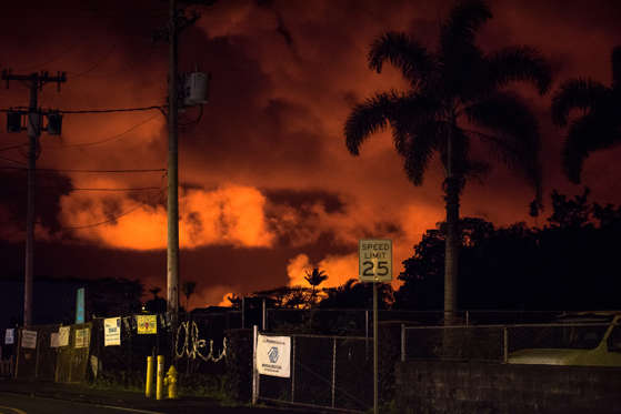 Slide 16 of 204: low from the lava in the Leilani Estates and Lanipuna Gardens subdivisions is seen from Pahoa, Hawaii on May 22, 2018.