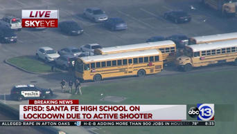 In this image taken from video, law enforcement officers respond to a high school near Houston after an active shooter was reported on campus, in Santa Fe, Texas.