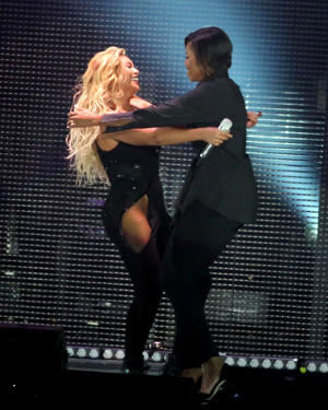 Beyonce and Michelle Obama hug during the 2015 Global Citizen Festival at Central Park on September 26, 2015 in New York City.