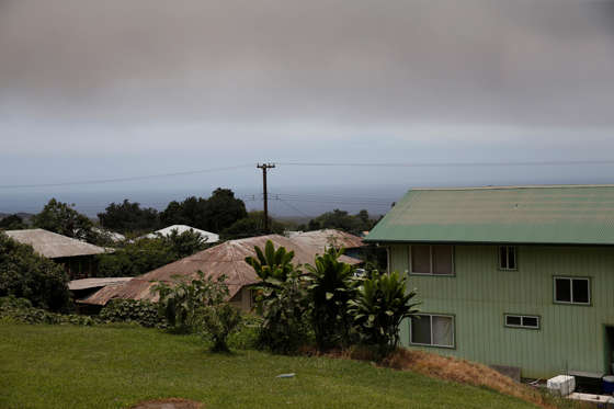 Slide 13 of 204: A volcanic ash cloud hovers in the distance during the eruption of the Kilauea Volcano in Pahala, Hawaii, U.S., May 23, 2018.  REUTERS/Marco Garcia