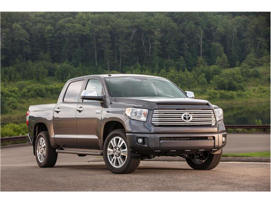 a car parked on the side of a road: 2018 Toyota Tundra