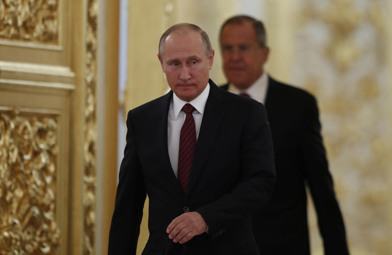 Russian President Vladimir Putin arrives for a ceremony of presentation of credentials in the Kremlin in Moscow, Russia, on Tuesday, Oct. 3, 2017. (AP Photo/Pavel Golovkin, pool)