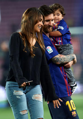 Slide 67 of 75: Leonel Messi smiles with his son Mateo Messi and wife Antonella Roccuzzo at the end the La Liga match between Barcelona and Real Sociedad at Camp Nou on May 20, 2018 in Barcelona, Spain.