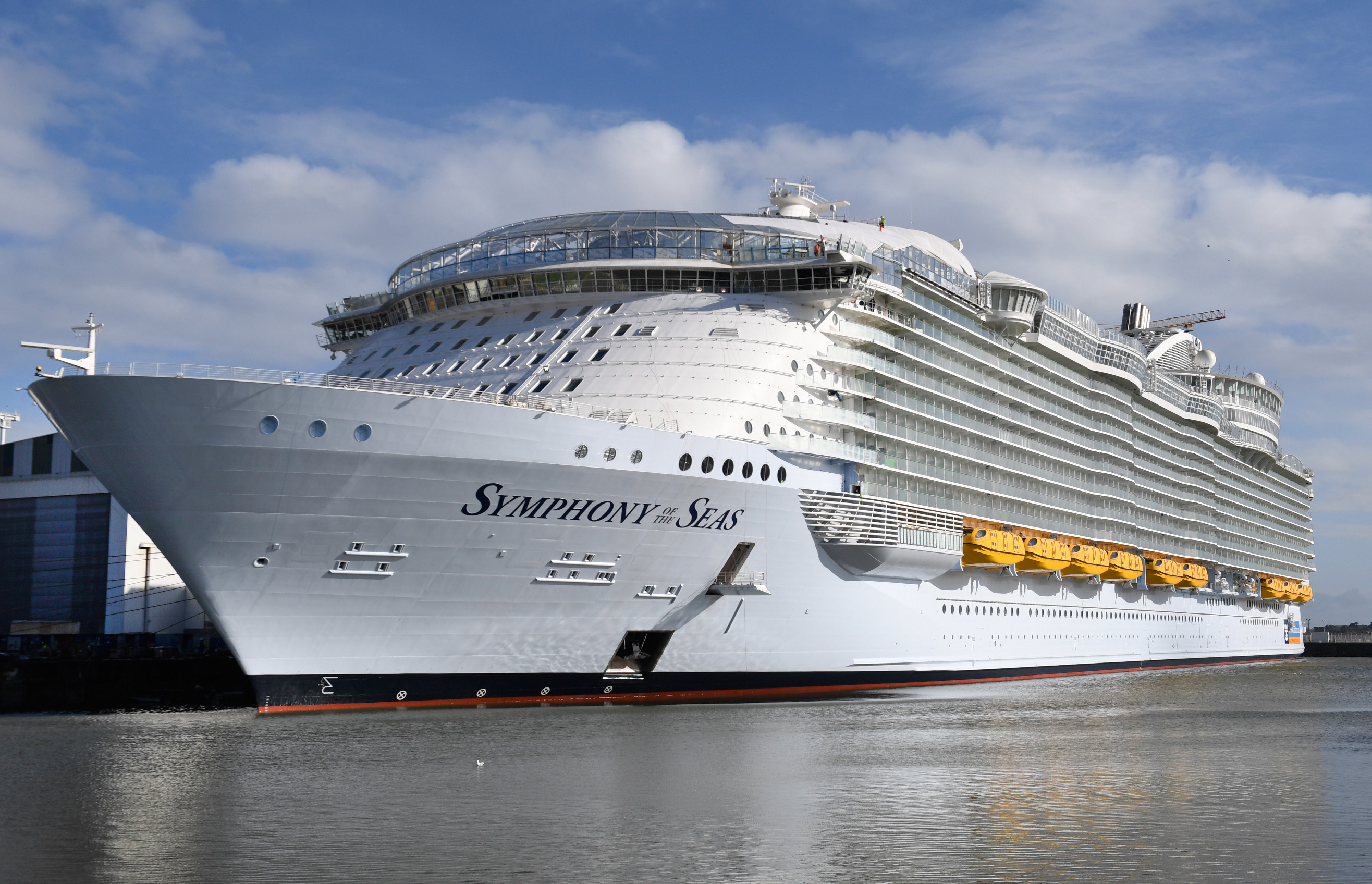 Slide 2 of 31: US shipowner Royal Caribbeans new Oasis-class cruise ship, Symphony of the Seas, the largest passenger ship ever to be constructed by gross tonnage and built by French shipyard STX, is pictured on February 13, 2018 in the port of Saint-Nazaire, western France. STX, whose origins date to 1861, has several cruise ships on order between now and 2026 for its two main clients, MSC Cruises and Royal Caribbean. Italian shipbuilding company Fincantieri announced on Februay 2, 2018 it had reached an agreement with France to buy 50 percent of the French shipyard STX. Symphony of the Seas is to be delivered to the Royal Caribbean by March, and will be able to accommodate 5,518 passengers at double occupancy up to a maximum capacity of 6,680 passengers, as well as a 2,200-person crew. / AFP PHOTO / Fred TANNEAU        (Photo credit should read FRED TANNEAU/AFP/Getty Images)