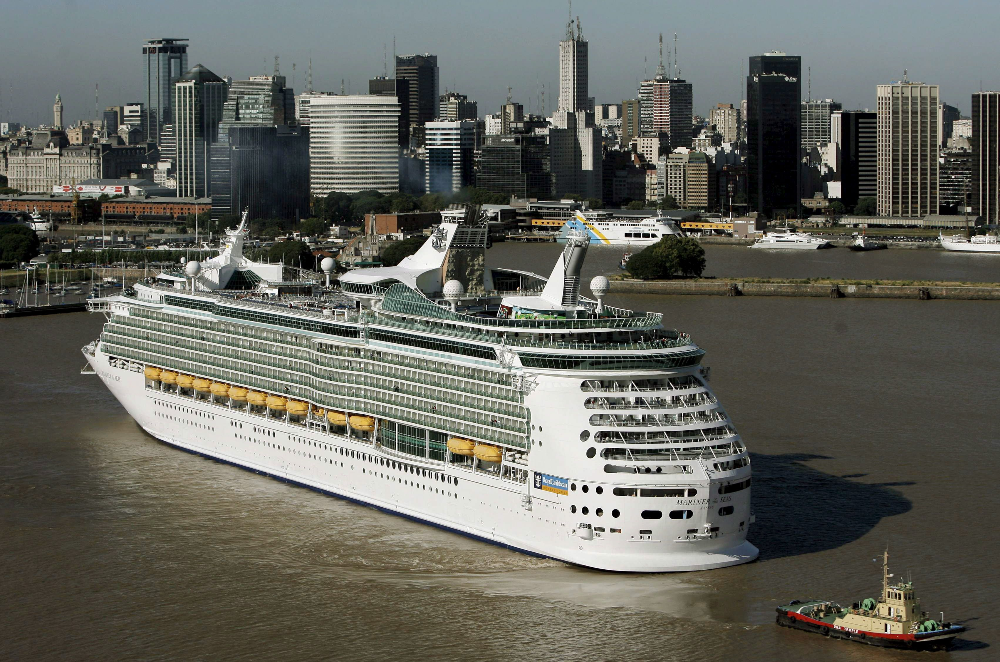 Slide 4 of 31: A View of the Cruise Liner 'Mariner of the Seas' on Its Arrival to the Port of Buenos Aires Argentina 'Mariner of the Seas' Which Belongs to Royal Caribbean Cruise Company Left From Puerto Ca±averal with 2 500 Persons on Board on 4 January and Will End the Crossing in Los Angeles on 3 February 2009 After 46 Days Journey Along North and South America the Cruise Liner is 311 M Long and 38 60 M Beam Some of Its Attractions Are an Ice Skating Rink a Golf Course of 19 Holes and a Basketball Court Argentina Buenos Aires