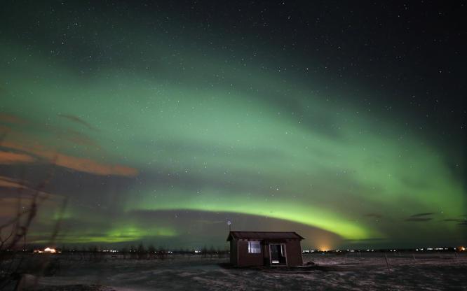 Slide 3 of 35: Aurora Borealis, or Northern Lights, over southern Iceland.