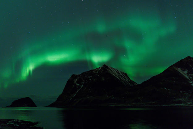 Slide 2 of 35: Northern Lights are pictured on March 9, 2018, in Utakleiv, northern Norway, Lofoten islands, within the Arctic Circle. / AFP PHOTO / OLIVIER MORIN (Photo credit should read OLIVIER MORIN/AFP/Getty Images)
