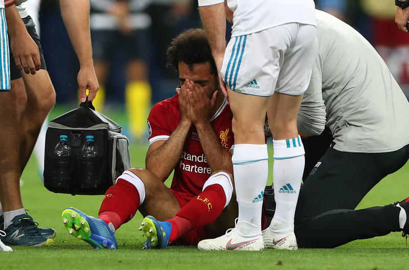 Soccer Football - Champions League Final - Real Madrid v Liverpool - NSC Olympic Stadium, Kiev, Ukraine - May 26, 2018   Liverpool's Mohamed Salah looks dejected as he receives medical treatment after sustaining an injury