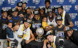 The Golden State Warriors pose with their trophy after defeating the Houston Rockets in Game 7 of the NBA basketball Western Conference finals, Monday, May 28, 2018, in Houston. (AP Photo/David J. Phillip)