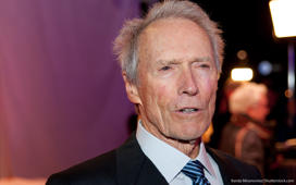 Clint Eastwood wearing a suit and tie: Clint Eastwood's Net Worth Reaches $375 Million on His 86th Birthday