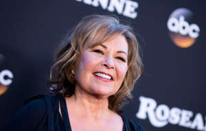 "a close up of Roseanne Barr: Roseanne Barr attends the series premiere of ""Roseanne"" in Burbank, Calif. on March 23, 2018.ABC canceled its hit reboot ""Roseanne"" on May 29, 2018 following lead Roseanne Barr's racist tweets about former Obama White House adviser Valerie Jarrett on Twitter."