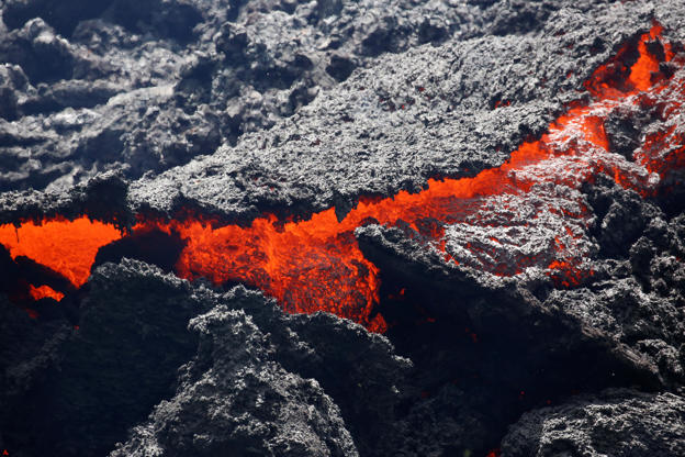 Slide 20 of 111: Lava erupts from a fissure east of the Leilani Estates subdivision during ongoing eruptions of the Kilauea Volcano in Hawaii, U.S., May 12, 2018.