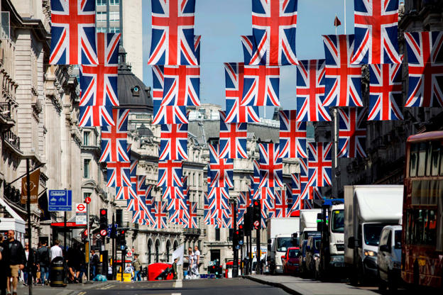 Slide 12 of 27: Union flag decorations are seen in Regent Street, London on May 11, 2018 ahead of the Royal Wedding of Prince Harry and US actress Meghan Markle. - Britain's Prince Harry and US actress Meghan Markle will marry on May 19 at St George's Chapel in Windsor Castle. (Photo by Tolga AKMEN / AFP)        (Photo credit should read TOLGA AKMEN/AFP/Getty Images)