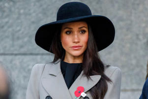 Meghan Markle wearing a hat: Meghan Markle attends the Anzac Day Dawn Service in London on April 25, 2018.