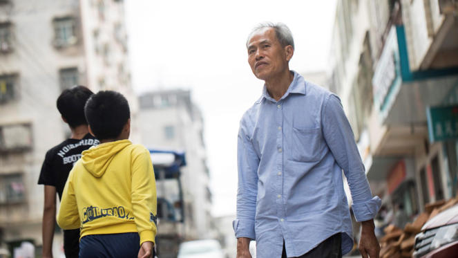 Junxiu Wang searched city streets and traveled almost 1,900 miles by train to try to find his son.