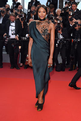 "Naomi Campbell et al. standing on a rug: Naomi Campbell attends the ""BlacKkKlansman"" premiere at the 71st Cannes Film Festival on May 4, 2018."