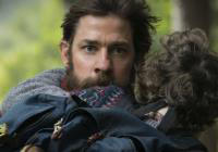 "This image released by Paramount Pictures shows actor-director John Krasinski on the set of ""A Quiet Place,"" with Noah Jupe."