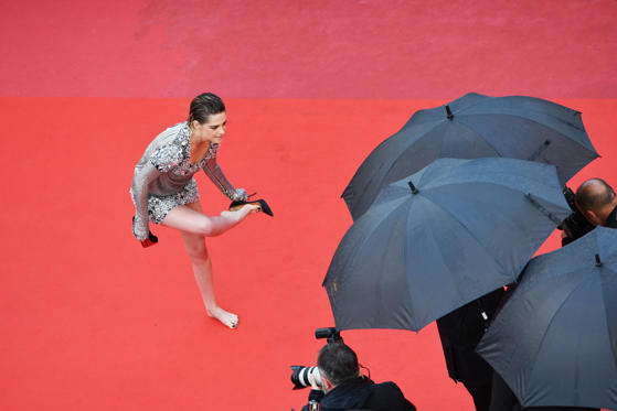 Slide 1 of 28: CANNES, FRANCE - MAY 14:  Kirsten Stewart takes off her shoes at the screening of 'Blackkklansman' during the 71st annual Cannes Film Festival at Palais des Festivals on May 14, 2018 in Cannes, France.  (Photo by Stephane Cardinale - Corbis/Corbis via Getty Images)