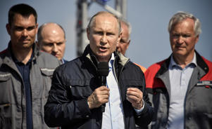 Russian President Putin takes part in a ceremony opening a bridge, which was constructed to connect the Russian mainland with the Crimean Peninsula across the Kerch Strait