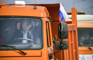 Russian President Putin drives a Kamaz truck during a ceremony opening a bridge, which was constructed to connect the Russian mainland with the Crimean Peninsula across the Kerch Strait