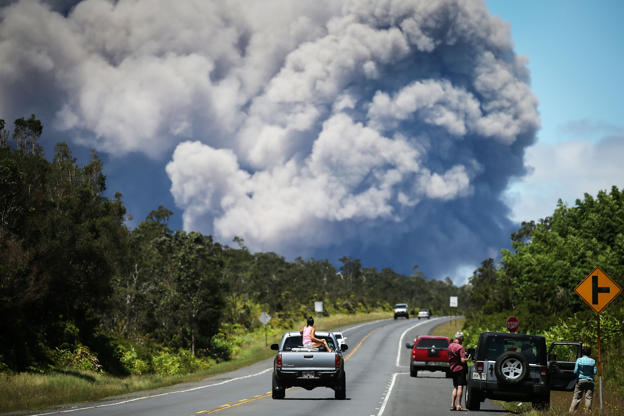 Slide 1 of 141: An ash plume rises from the Kilauea volcano on Hawaii's Big Island on May 15, 2018 in Volcano, Hawaii. The U.S. Geological Survey said a recent lowering of the lava lake at the volcano's Halemaumau crater 'has raised the potential for explosive eruptions' at the volcano.