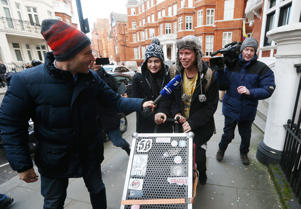Alleged computer hacker Lauri Love (centre), the day after he won his High Court appeal against extradition to the US, leaves the Ecuadorian embassy in London, with his girlfriend Sylvia Mann after visiting WikiLeaks founder Julian Assange.