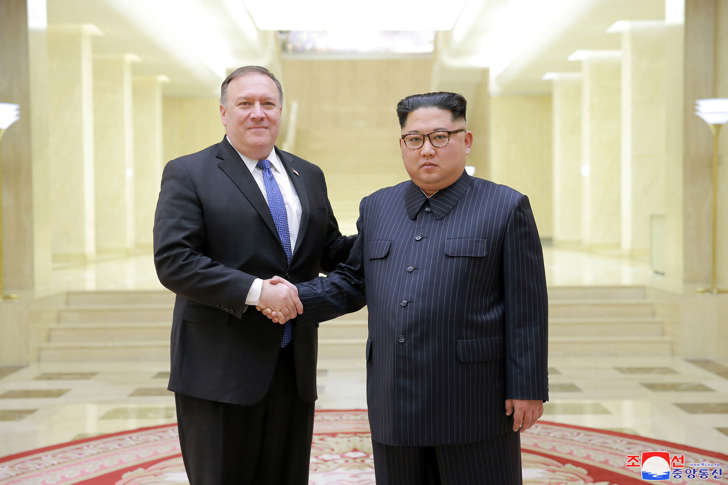 U.S. Secretary of State Mike Pompeo, left, poses with North Korean leader Kim Jong Un for a photo during a meeting at the Workers' Party of Korea headquarters in Pyongyang, North Korea.