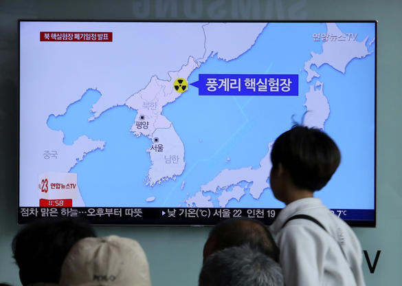 "Slide 4 of 138: People watch a TV screen reporting that North Korea will dismantle nuke test site during a news program at the Seoul Railway Station in Seoul, South Korea, Sunday, May 13, 2018. North Korea said Saturday that it will dismantle its nuclear test site in less than two weeks, in a dramatic event that would set up leader Kim Jong Un's summit with President Donald Trump next month. Trump welcomed the ""gracious gesture."" The signs read: "" Punggye-ri nuclear test."" (AP Photo/Ahn Young-joon)"