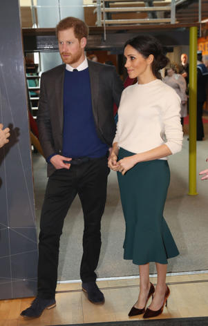 Prince Harry, Meghan Markle standing in a room: Prince Harry and Meghan Markle visit Catalyst Inc, Northern Ireland's next generation science park, to meet young entrepreneurs and innovators in Belfast on March 23, 2018.