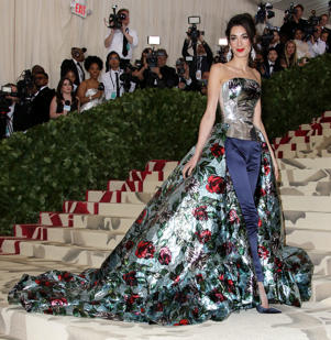 Amal Clooney et al. standing in front of a crowd: Amal Clooney attends The Metropolitan Museum of Art's Costume Institute Benefit celebrating the opening of Heavenly Bodies: Fashion and the Catholic Imagination in New York City on May 7, 2018.