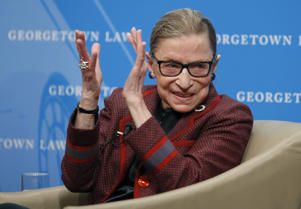 Supreme Court Justice Ruth Bader Ginsburg applauds after a performance in her honor after she spoke about her life and work during a discussion at Georgetown Law School in Washington on Friday, April 6, 2018.