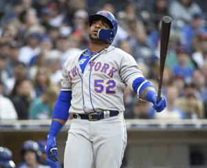 a baseball player holding a bat: Yoenis Cespedes has been dealing with a nagging hip flexor/right quad issue.