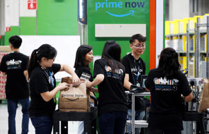 Employees work at Amazon's Prime Now fulfillment centre in Singapore