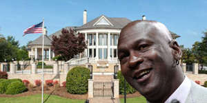 Michael Jordan standing in front of a building