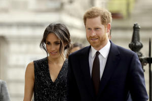 "FILE - In this Monday, April 23, 2018 file photo, Britain's Prince Harry and his fiancee Meghan Markle arrive to attend a Memorial Service to commemorate the 25th anniversary of the murder of black teenager Stephen Lawrence at St Martin-in-the-Fields church in London. German royalists' adrenaline has been surging as the Saturday, May 19 wedding of Prince Harry and his American bride-to-be Meghan Markle is creeping closer. There's no way anybody here will be able to miss the event: Three German TV stations, ZDF, RTL and n-tv, will broadcast the event live and stream it on their websites too. Dozens of German correspondents are accredited and so-called ""royal household experts"" will explain the intricacies of the foreign ceremony. (AP Photo/Matt Dunham, file)"