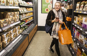 Shopper Ela Ustel walks through the Amazon Go store, on January 22, 2018 in Seattle, Washington. After more than a year in beta Amazon opened the cashier-less store to the public.