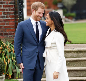 Prince Harry in a suit standing in front of a building: Prince Harry Meghan Markle First Date