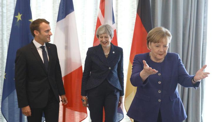 French President Emmanuel Macron, British Prime Minister Theresa May and German Chancellor Angela Merkel meet during the EU-Western Balkans Summit in Sofia, Bulgaria, May 17, 2018.