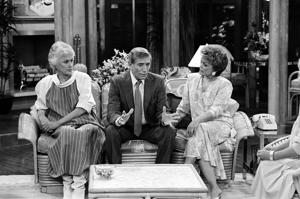 THE GOLDEN GIRLS -- 'To Catch a Neighbor' Episode 24 -- Pictured: (l-r) Bea Arthur as Dorothy Petrillo Zbornak, Joseph Campanella as Al Mullins, Rue McClanahan as Blanche Devereaux  (Photo by Ron Tom/NBC/NBCU Photo Bank via Getty Images)